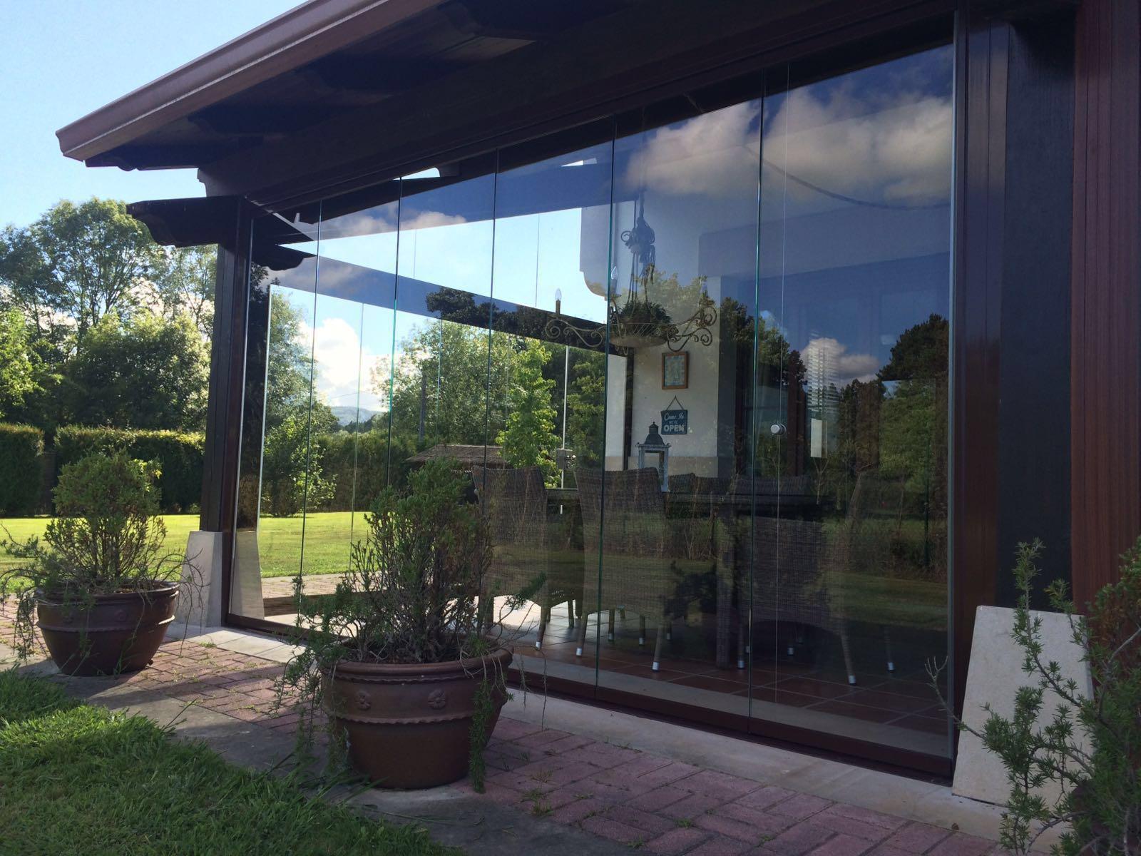Cortina de cristal en porche en Madrid